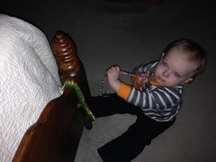 """Playing with Mardi Gras Beads in Davy's Room • <a style=""""font-size:0.8em;"""" href=""""http://www.flickr.com/photos/109120354@N07/15933770557/"""" target=""""_blank"""">View on Flickr</a>"""