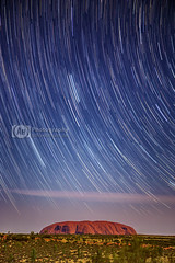 Celestial Rock (artjom83) Tags: longexposure travel summer sky moon nature rock night stars bush desert nt australia roadtrip astro clear backpacking outback uluru lit australien ayers downunder startrails worldheritage northernterritory yulara 2014 canon6d