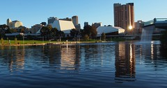 Adelaide skyline from the River Torrens bank, November 2014 (Adriano_of_Adelaide) Tags: city reflection water fountain buildings evening afternoon footbridge adelaide cbd ripples riverbank centralbusinessdistrict festivalcentre intercontinentalhotel rivertorrens cityofadelaide torrenslake riverbankprecinct