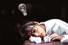 Lack of Inspiration (isabs) Tags: sleeping portrait white inspiration lamp girl self paper glasses sleep dream tired conceptual bun lack exausted