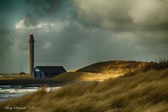 Lighthouse at Zoutelande - Vuurtoren (schreudermja) Tags: sea lighthouse beach strand coast dunes dune nederland thenetherlands zee duinen vuurtoren duin kust knrm zoutelande europeanbeachgrass helmgras ammophilaarenaria europeanmarramgrass samsungnx30 martyschreuder