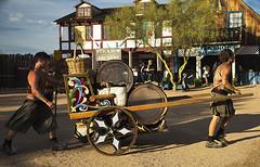 Pushing a cart 8635PatLam (Studio5301) Tags: costumes festival kids children drums kilt bellydancer drummer faire clan renaissancefaire chld arizonarenaissancefestival fairycostumes studio5301 festivalsinphoenix patricialam patricialamphotographycom