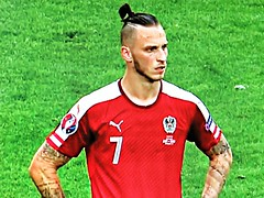Looking Clueless (knightbefore_99) Tags: dumb ridiculous tattoo futbol football 2016 euro manbun stupid austria red silly ugly marko arnautovic stoke deranged screenshot