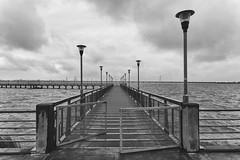 La entrada... (Pablin79) Tags: longexposure bridge light sky white black water argentina monochrome clouds river pier iron afternoon misiones posadas