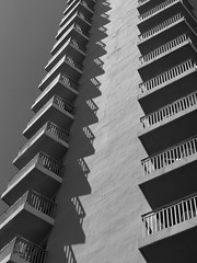 Tall storeys (Andy WXx2009) Tags: sunlight shadows building apartment streetphotography structure monochrome city skyline artistic skyscrapers tower veranda cityscape benidorm spain espana europe resort modern floors construction sky