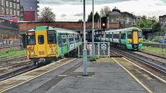 Southern Simultaneaous Arrivals. at Clapham Junction. (ManOfYorkshire) Tags: trains railway station southern class455 class377 electrostar multiple units electric thirdrail claphamjunction arrivals enter platform signal simultaneous yellowline edge