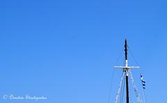 Greek flag waving on the wind (Dimitris Stratigentas) Tags: travel blue summer sky fun greek europe mediterranean ship cross wind flag sony aegean greece sail mast waving