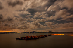 Trasimeno in the moonlight (Alessandro Nenci) Tags: winter sunset sky italy cloud lake water night canon dark stars lago eos gold rocks long exposure italia nuvole cielo moonlight inverno notte umbria buio trasimeno scogli 450d