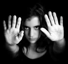 Girl with hands signaling to stop (alimousavi) Tags: portrait people white black girl monochrome beautiful sign female race dark person kid fight child hand sad symbol serious no background fear small young teen domestic human stop crime rights latin teenager violence brave hispanic latina afraid drama signal limit isolated gender threat struggle abuse racial discrimination determination frightened bullying intimidation deny negation unitedkingdomofgreatbritainandnorthernireland