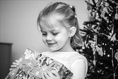 finally he came (pajus79) Tags: show christmas xmas eve light shadow portrait bw white black tree girl face look contrast happy evening kid nikon view action joy daughter young front delight gift shade present came pleasure finally expect happyness aneka d80 55200456