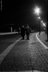 (Georgina ) Tags: love walking movement couple streetlamps streetphotography athens cobblestones romantic oldercouple