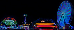 north midway panorama (pbo31) Tags: california carnival winter panorama motion black color night dark oakland evening march nikon ride large fair panoramic spinning bayarea zipper ferriswheel eastbay traveling stitched alamedacounty d800 2015 lightstream boury pbo31 patrickboury