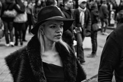 Beautiful stylish blonde girl with big hat - IMG_1688-Edit (roger_thelwell) Tags: life street city uk winter portrait england people urban bw white black streets cold london lamp girl monochrome beautiful westminster beauty hat rain leather mobile umbrella hair bag walking real photography mono big chat shiny phone with traffic post natural photos britain circus cigarette candid cab taxi great over sac hats cell photographic smoking lamppost photographs oxford blonde conversation shiney talking shoulder handbag stud speak speaking studs commuters stylish scak