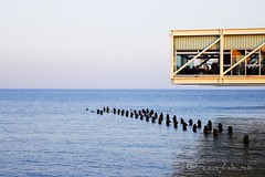 dining over water... (ggcphoto) Tags: dining stilts sea themediterraneansea bluesea building restaurant sunset horizon cyprus limassol