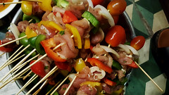 Ready for the flame (Roving I) Tags: barbecues skewers rawmeat foodpreparation chicken tomatoes peppers cabanon cafes danang dining vietnam