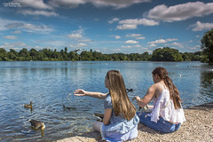 Nothing to be Blue about.......Happy Days (Carl Yeates) Tags: sky blue clouds girls children ducks feeding lake water canon550d park ellesmere
