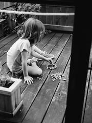 Wild Detectives (BurlapZack) Tags: olympusomdem5markii panasonicleicadgsummilux25mmf14 vscofilm pack06 dallastx oakclifftx wilddetectives oakclifffilmfestival ocff filmfestival child rocks play porch backyard rock pattern circle arrange imagination bw mono monochrome summer summertime kid innocence