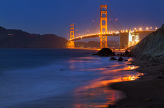 Liquid Gold (Sairam Sundaresan) Tags: sanfrancisco longexposure bridge blue cliff seascape color colour reflection colors canon reflections stars coast long colours curves cliffs goldengatebridge le goldengate 5d canon5d seashore sairam canon5dmarkiii 5dmarkiii sairamsundaresan