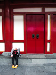 Exhausted in a changing landscape (wongyoonsann) Tags: street red urban girl yellow modern contrast hair temple singapore chinatown buddha traditional chinese culture tired rest coloured buddhatoothrelictemple