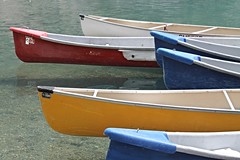 Moraine Lake ~ colorful canoes (karma (Karen)) Tags: canada texture topf25 boats lakes canoes alberta brightcolors 4summer clearwater morainelake canadianrockies banffnp cmwdyellow canadanationalparks