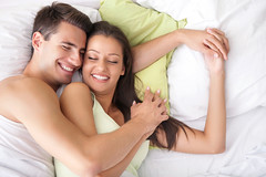 Young happy couple in bed (menshealthcentre) Tags: morning family sleeping people woman man sexy male love boyfriend girl beautiful beauty smiling horizontal comfortable female togetherness bed hugging bedroom girlfriend couple married serbia joy young relaxing handsome lifestyle peaceful happiness husband romance sensual pillow relationship together sheet leisure copyspace relaxation lying pleasure sexuality 20s caucasian wellbeing embracing