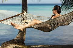 Young Woman Relaxing in a Hammock in Heavenly Place (Marcos Felipe T.D.) Tags: travel blue sea summer sun sunlight tree beach nature water beautiful beauty outdoors polynesia women heaven horizon sunny bluesky hammock watersedge resting relaxation youngadult idyllic vacations scenics swimwear oneperson lifestyles frenchpolynesia summerresort beautyinnature healthylifestyle beachtree coconutpalmtree touristresort horizonoverwater rangiroaatoll indopacificocean travellocations