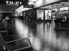 """Imaginary Meeting Point"" (helmet13) Tags: iphone6s bw people women man poster promotion airport departurehall waiting boredom aoi heartaward peaceaward world100f 100faves"