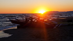 Sunset boat (ken Dowdall) Tags: sundown landscape italy tuscany sunset beach sea water themed surf waves boat lifeboat oars rowingboat