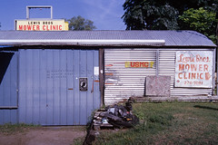 Lewis Bros Mower Clinic (jhunter!) Tags: kodakportra400 nikonf4 tokina2035f28