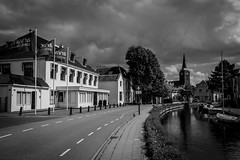 Abcoude cityview (PaulHoo) Tags: abcoude holland netherlands contrast 2016 nikon d700 summer gein river clouds sky cityscape city urban bw blackandwhite monochrome church lines road street building architecture