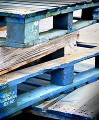 Pallets in the Rain (Carolbreeze99) Tags: dorset portland pallets rain colour blue azure abstract shape geometry texture