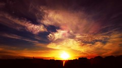 Sunset over the city (michelecarbone900) Tags: sunset sky sun clouds city cielo light landscape red ray