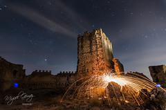 Castle on fire (Miguel Gomez Photo) Tags: almonacid castillo castle chispas edificio espaa estrellas lanadeacero noche nocturno stars torre almonaciddetoledo lightpainting tower night toledo largaexposicion long exposure longexposure