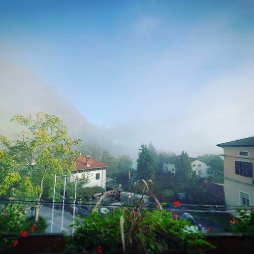 Fog is slowly lifting over the lake, its going to be a perfect day for a hike. #fog #mist #water #lake #hills #mountains #alps #soca #isonzo #alpine #river #mostnasoci #socavalley #slovenia #igslovenia #igposocje