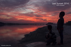 The Last Sunset Of 2014 (saikia.buddha) Tags: sunset people cloud india water clouds last river landscape dusk assam guwahati reflaction 2014 flickrtravelaward