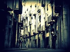 Sweeping Girona (Robert-Jan van Lotringen) Tags: street morning light sun white black girl mono early spain mood pov streetphotography atmosphere oldman girona cleaning espana catalunya oldtown gerona sweeping monumental streetshot sweeper splittone