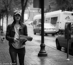 Here comes the rain again... (justis.kivari) Tags: street dog girl monochrome rain canon nashville tennessee 2ndave t2i