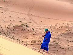 morocco (gerben more) Tags: blue man sahara sand cellphone morocco sanddune marokko