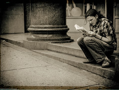Book Worm - Vancouver, Canada (Matthew Dyck) Tags: street camera city portrait urban bw white canada black eye vancouver square lens four photography prime flickr fotografie matthew candid creative commons scout olympus scene snap best explore crop squareformat third mindfulness eyed 20mm moment 18 unposed left contemplative mirco 45mm omd tog decisive em1 mft dyck strassenfotografie flickriver streettog