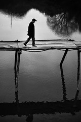 fear is best faced from a higher elevation~ Anhui (~mimo~) Tags: china old bridge blackandwhite man mountains reflection water hat yellow walking fear documentary elevation huangshan anhui longchuan