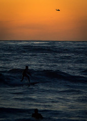 The Race (Marvin Perry) Tags: california sunset beach water chopper surf waves unitedstates sandiego horizon wave lajolla surfing racing helicopter beaches surfers boogieboard crashingwaves windandseabeach crashingwave windanseabeach managainstmachine windanesea
