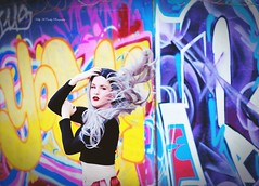 Vibrant Storm (Kelly McCarthy Photography) Tags: city urban woman abandoned beautiful beauty fashion pose hair graffiti model colorful makeup style flip lipstick whitehair catchycolorsyellow catchycolorsblue catchycolorspurple croptop silverhair