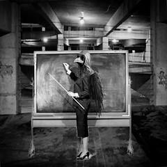 Today's Lesson (Flamenco Sun) Tags: surreal surrealist blackboard parkinglot carpark lesson teacher plague plaguedoctor disturbing dark weird