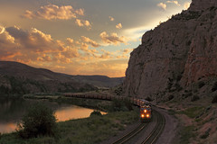 Lombard sunset (Moffat Road) Tags: railroad sunset sky mountains water rock clouds train river montana mt cliffs locomotive curve bnsf lombard mrl missouririver graintrain montanaraillink unittrain lombardcanyon mrlsecondsubdivision mrl2ndsub