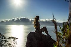 A Beautiful Place (johnnycipriani) Tags: sun light sky blue cloud nuvem mar ocean sea oceano people pessoa natureza nature rock pedra rocha azul sol praia beach santa catarina brazil bombinhas