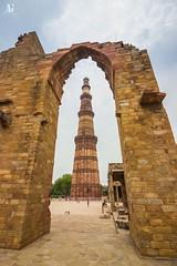 Qutub Minar (1/2) (Adithya Ganesan) Tags: architecture delhi india 2016 colors clouds canon qutub minar
