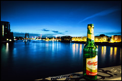 Weekend-Feeling (Krueger_Martin) Tags: water spree reflex reflections spiegelung nacht night city stadt urban bottle nightlife flasche bier beer fernsehturm bokeh beyoundbokeh light lights licht hdr photomatix langzeitbelichtung osthafen sigma weitwinkel ultraweitwinkel wideangle sigma1224mmexdghsm canoneos7d colorful bunt farbig budweiser moleculareman berlin blau blue