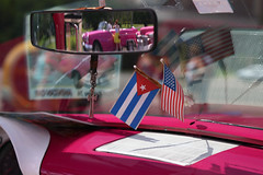Sign o' the times (Robyn Hooz) Tags: classic cars macchine cuba revolucion placa square piazza taxi american cuban flag bandiere