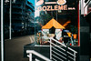 Shopkeeper dreaming. Waterloo, 2016. (Albion Harrison-Naish) Tags: waterloo sydney newsouthwales nsw australia streetphotography sydneystreetphotography albionharrisonnaish nikon nikond750 d750 nikkor50mm14g