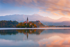 Autumn sunrise in Slovenia (pieter.struiksma) Tags: lake bled morning sunrise slovenia clouds mountains sky water reflections autumn church island brilliant wow